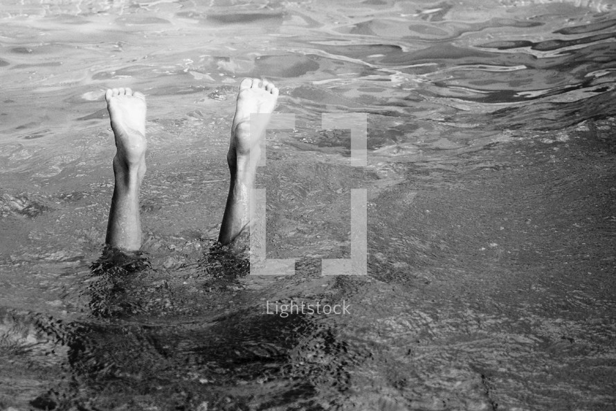 feet from a child diving into water
