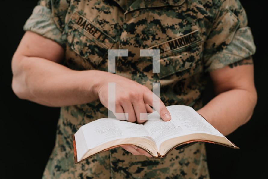 Marine reading a Bible