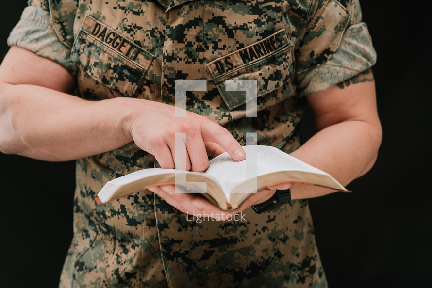 A marine reading a Bible