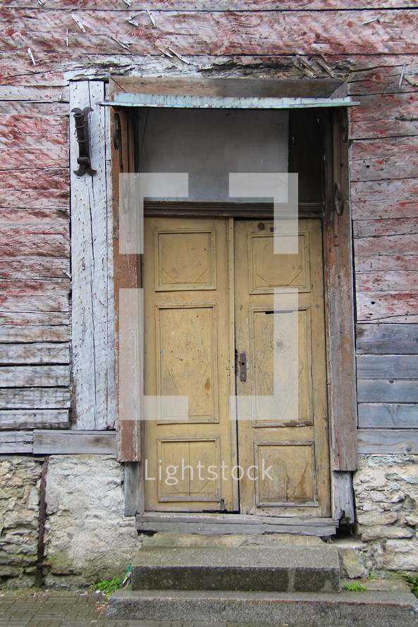 Door on an old deserted building