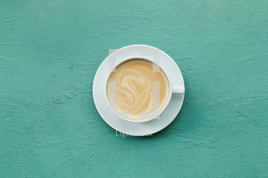 latte on a teal background