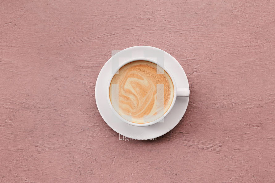 coffee cup on a blush background