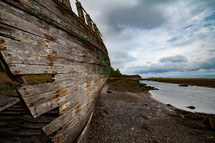 Hull of a shipwreck at Dulas Bay at low tide