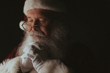 Santa Claus with praying hands