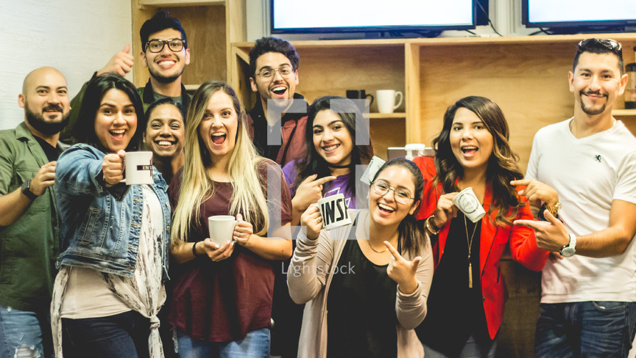 young adult group with coffee mugs