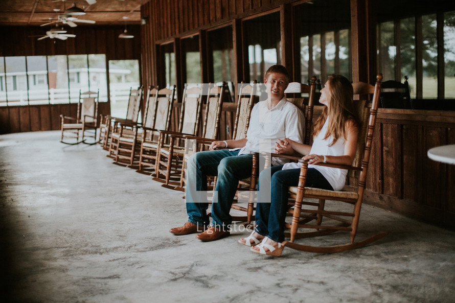 couple rocking in rocking chairs