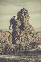 A man climbing a rock formation.