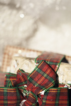 Red and green bows on wrapped gifts