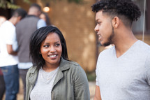 college students talking together on campus