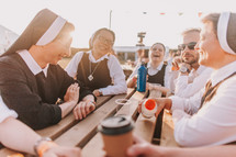group of nuns talking and laughing in conversation