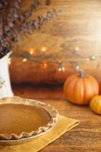 Pumpkin Pie on a Kitchen Counter with Lights