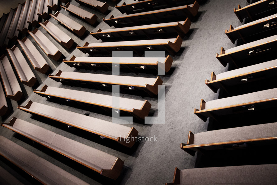 rows of empty pews in a church