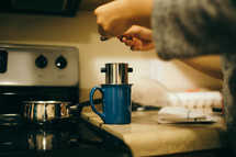brewing coffee on the stove