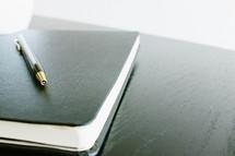 pen on a journal