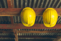 hard hats on a hook