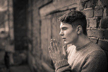 a teen boy with praying hands