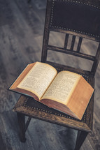an open book on a chair
