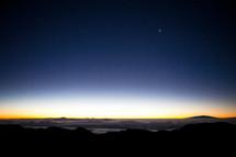 horizon over mountaintops at dawn