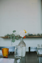 flowers in vases on a table for a wedding reception