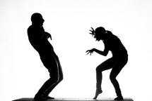 silhouettes of mimes on stage