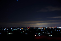 bokeh lights from a distant suburb at night
