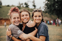 hugging teen girls