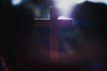sunlight on a wooden cross