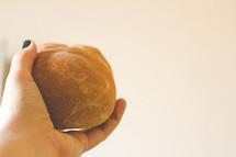 hand offering bread