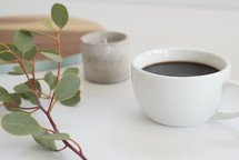 eucalyptus, twigs, coffee cup, votive, candle