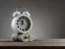 alarm clock and roll of cash