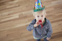 A toddler wearing a party hat
