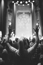 hands raised in worship at a worship service