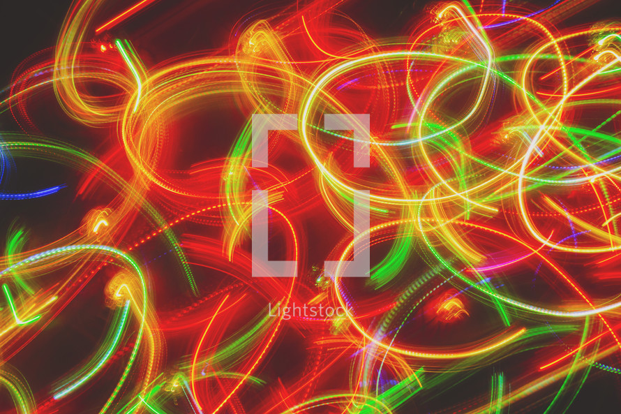 a long exposure of coloured lights while twirling the camera