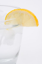 slice of lemon on a glass of water