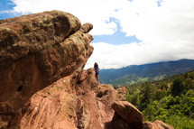 woman climbing on a red rock