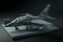 RUSSIA / YAK-130 - 2019. Miniature of military fighter on a black background with place for text