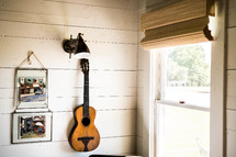guitar hanging on a wall