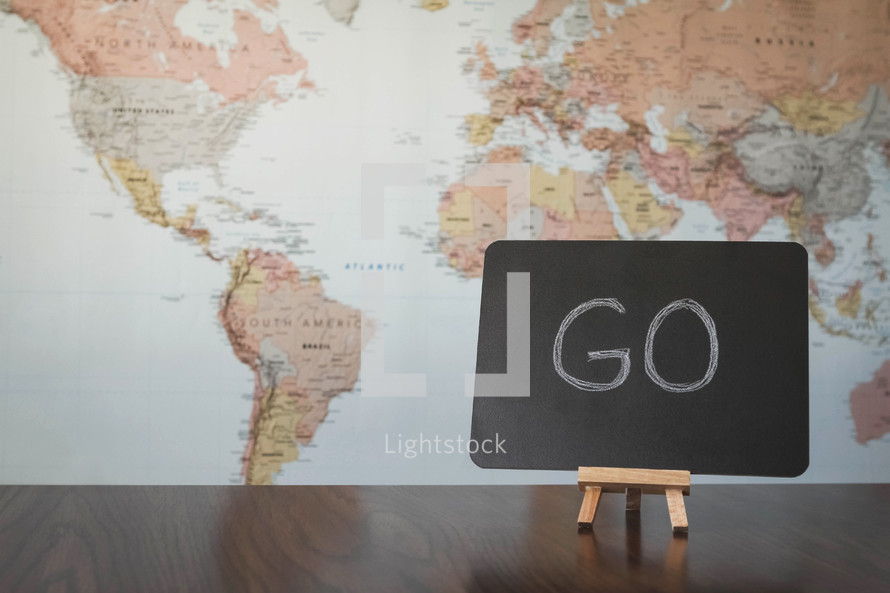 world map and word go on a sign