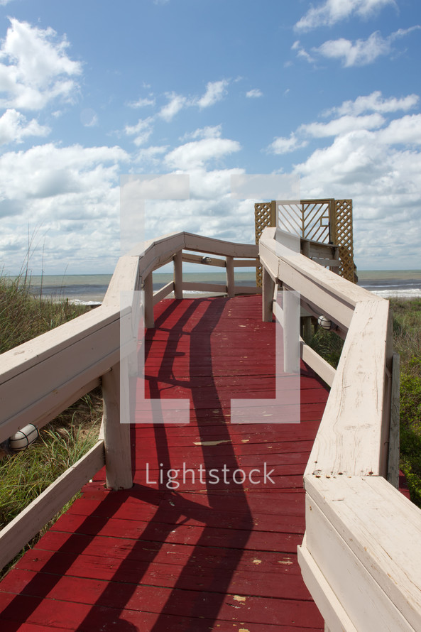 red wood walkway to a beach