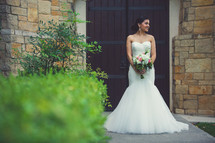a beautiful Latino bride in her wedding gown