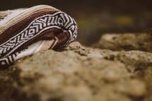 A blanket on a rock