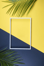 empty frame and palm fronds