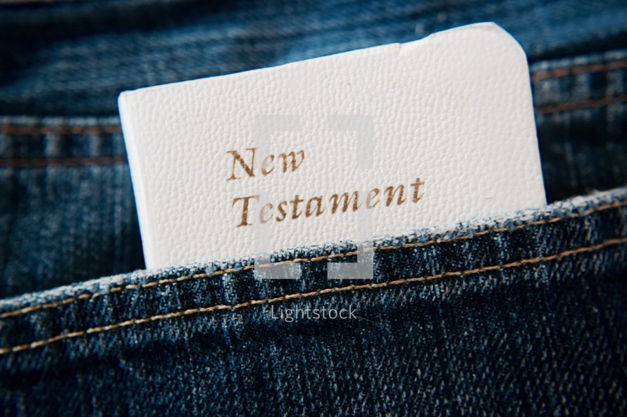 New Testament pocket Bible in a jeans pocket