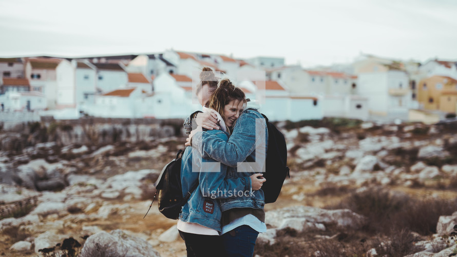 couple hugging on a beach in fall