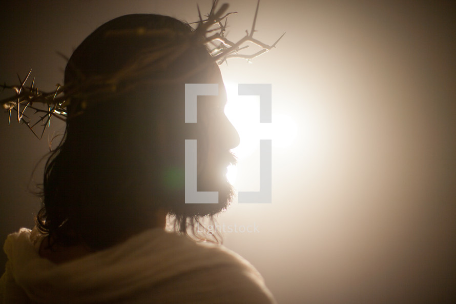 Jesus with a crown of thorns surrounded by glowing light