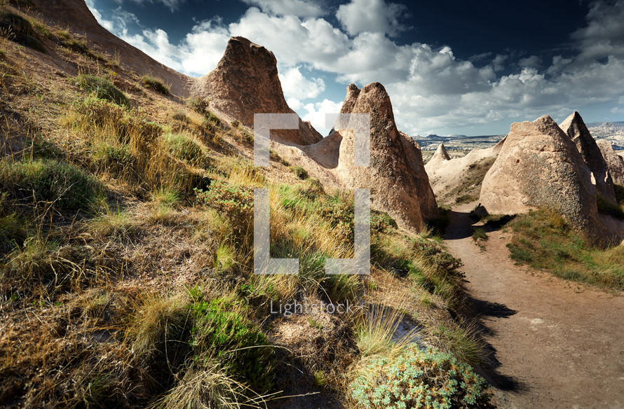 smooth rocks and path in a desert landscape. Cappadocia, Turkey