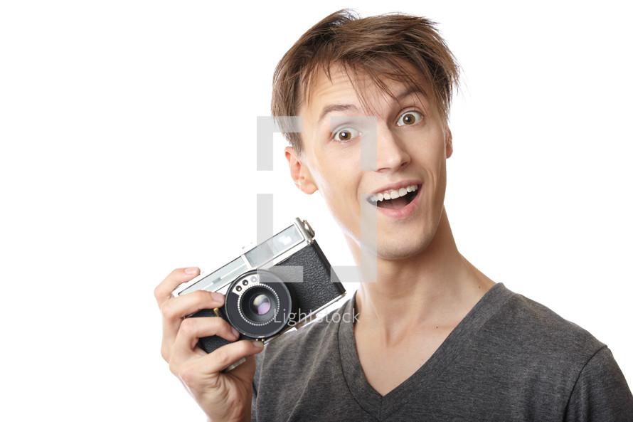 a happy man holding a camera