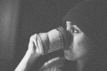 A woman drinking coffee in a mug