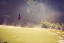Sunshine on a golf green.
