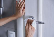 cleaning a doorknob